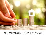 the coins are stacked in  three ... | Shutterstock . vector #1054719278
