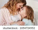 mother and daughter portrait at ... | Shutterstock . vector #1054724552