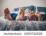 family feet. young family are...   Shutterstock . vector #1054732028