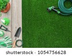 Gardening Tools On A Wooden...