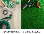 gardening tools on a wooden... | Shutterstock . vector #1054756652