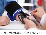 female doctor arms make medic... | Shutterstock . vector #1054761782