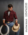 the sexy cowboy man awaits his... | Shutterstock . vector #1054762535