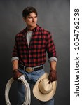 the sexy cowboy man awaits his... | Shutterstock . vector #1054762538