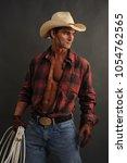 the sexy cowboy man awaits his... | Shutterstock . vector #1054762565
