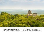 mayan ruins rise above the... | Shutterstock . vector #1054763018