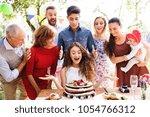 family celebration or a garden... | Shutterstock . vector #1054766312