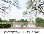 empty white park bench in the... | Shutterstock . vector #1054767608