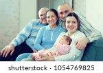 happy three generations family... | Shutterstock . vector #1054769825