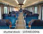 interior of a passenger train...   Shutterstock . vector #1054810046