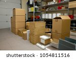 small warehouse with cardboard...   Shutterstock . vector #1054811516