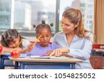teacher in a multi ethnic... | Shutterstock . vector #1054825052