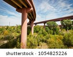beneath the elevated freeway... | Shutterstock . vector #1054825226