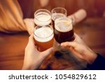 friends clinking and toasting... | Shutterstock . vector #1054829612