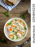 chicken and wild rice soup.... | Shutterstock . vector #1054843235