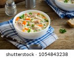 chicken and wild rice soup.... | Shutterstock . vector #1054843238