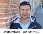 handsome blue eyed man smiling... | Shutterstock . vector #1054844918