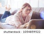 being online. cheerful pretty... | Shutterstock . vector #1054859522