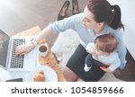 freelance job. top view of a... | Shutterstock . vector #1054859666