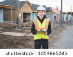 construction supervisor... | Shutterstock . vector #1054865285
