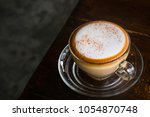 hot cappuccino coffee on the... | Shutterstock . vector #1054870748