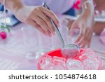 close up to hands add ice to... | Shutterstock . vector #1054874618