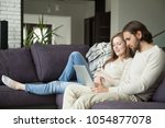 young family couple using... | Shutterstock . vector #1054877078