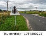 humorous danger road sign... | Shutterstock . vector #1054880228