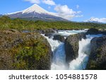 petrohue waterfalls with osorno ...   Shutterstock . vector #1054881578