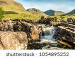 river etive waterfall in the... | Shutterstock . vector #1054895252