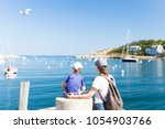 tourists on the pier admire the ... | Shutterstock . vector #1054903766