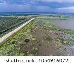 protective dam against flooding ... | Shutterstock . vector #1054916072