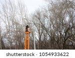 technician works in a bucket... | Shutterstock . vector #1054933622