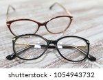 two pairs of stylish women's... | Shutterstock . vector #1054943732