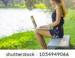attractive women using laptop...   Shutterstock . vector #1054949066