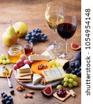 grape  cheese  figs and honey... | Shutterstock . vector #1054954148