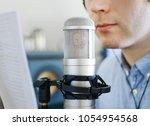 man recording an advertisement...   Shutterstock . vector #1054954568