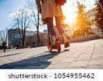 feet on the scooter. the girl... | Shutterstock . vector #1054955462