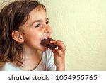 tanned girl enjoys a slice of... | Shutterstock . vector #1054955765