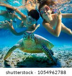 underwater photo of children... | Shutterstock . vector #1054962788