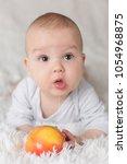 few months old baby boy on soft ... | Shutterstock . vector #1054968875