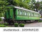 personal green train wagon of... | Shutterstock . vector #1054969235