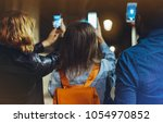 group adult hipsters using in... | Shutterstock . vector #1054970852