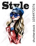 stylish lady in cap. hand drawn ... | Shutterstock .eps vector #1054972076