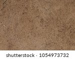 old stone wall of roof  | Shutterstock . vector #1054973732
