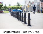 fencing pillars barriers in a... | Shutterstock . vector #1054973756