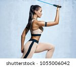 strong woman using resistance... | Shutterstock . vector #1055006042