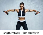 athletic woman doing exercise...   Shutterstock . vector #1055006045