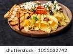 cheese plate  parmesan  cheddar ... | Shutterstock . vector #1055032742
