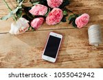 smartphone on the wooden table... | Shutterstock . vector #1055042942